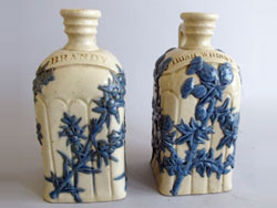 Pair of Lambeth Spirits Decanters. Note the spelling of 'Whisky'. Each decanter is 8in tall, 4in wide and 4in deep.